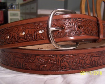Leather belt embossed with wildlife