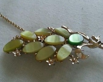 Gold tone Leaf Spray Brooch with Green Thermostat Stones