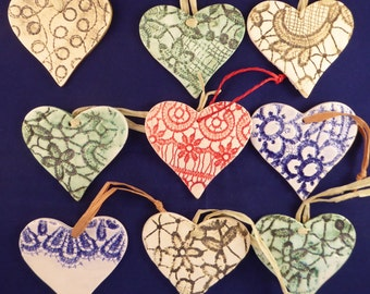 Embossed hand made earthenware love hearts in various colours