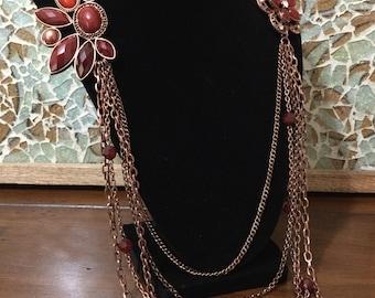 copper colored floral necklace