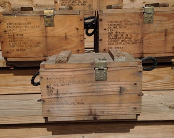 Vintage military ammo boxes/launcher projectile