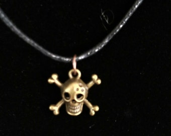 skull and cross bones on a hemp necklace