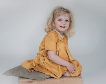Yellow Girl's Dress by GUDZYK.  Shot Sleeve.Front pockets. Fabric: Coton.