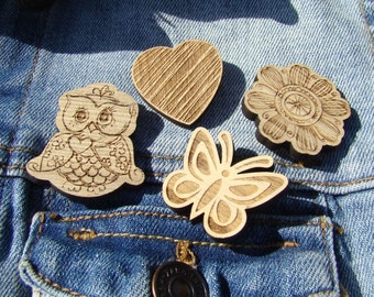 A set of wooden brooches