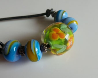 Lampwork glass and leather necklace