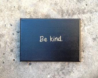 Gold glitter on black Canvas - 'Be kind.' - artwork