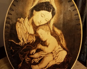 Pyrography of a Madonna in birch wood