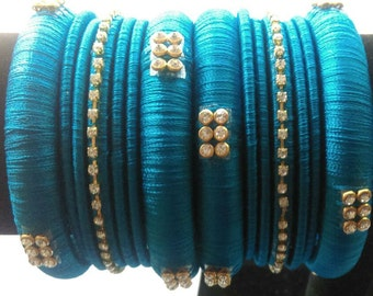 Pink with gold color silk thread bangles set - Green And Red Traditional Bangles With 14 By Shyamalikadesigns