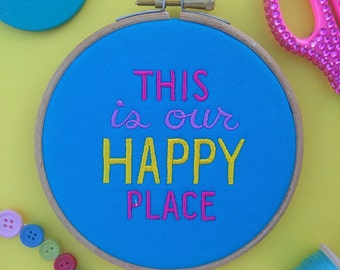 This is our Happy Placce embroidery hoop art