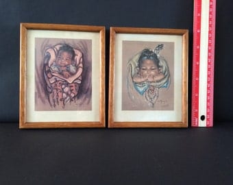 Chris Toffersey Native Art. Two Indian babies wrapped in their pa-poos. Muted colours set in their original frames.