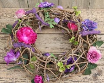 Colorful wreath with artificial flowers