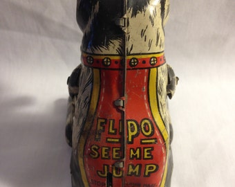 Flipo See Me Jump Tin Toy