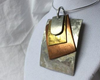 Handmade unique mixed metal pendant
