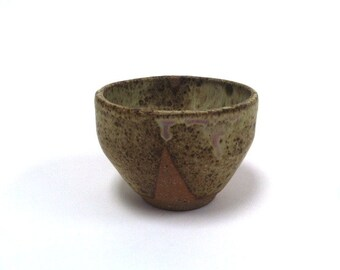 Small melted abstract tea bowl, matte with raw clay designs on the side