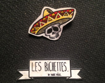 skull brooch at the sombrero