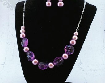 Purple faceted and pearl beaded statement necklace and earring set