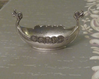 "Nordic pewter viking ship marked ""Handstodt"" on the bottom and decorated with the word ""NORGE"" on the side"