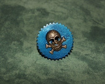 Mechanical clockwork with skull and crossbones ring