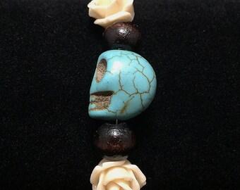 Day of the dead turquoise skull bracelet.