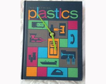 Clock of vintage book Plastics with green hands