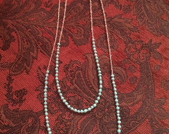 Sea green and clear seed bead necklace.