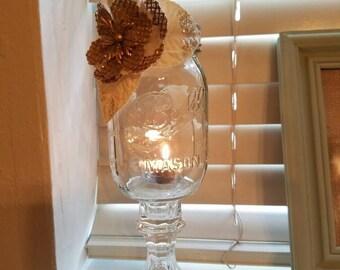 Beautiful mason jar votive with burlap flowers