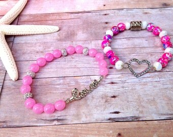 Stackable love beacelets, pink beads, silver beads, love charm, heart charm