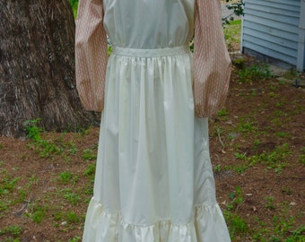 Ladies, size 12/14 Pioneer/Prairie costume in caramel print with pale yellow pinafore.