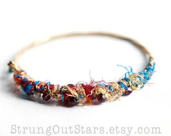 Strung-Out guitar string bangle with silk yarn garnet citrine
