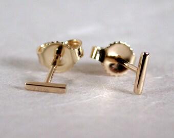 5mm x 1mm Tiny Bar Gold Earrings Thin Minimal Studs 14k Yellow Gold Staple Earrings Skinny Mini Bar Studs by SARANTOS
