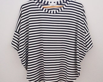 Side slit ponchos with cuffed sleeve. Black and white stripe. Nursing top. Layering top.