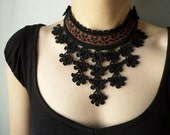 Beaded crochet statement necklace with sienna brown base and black beaded crocheted flower lace
