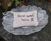 Lavender sachet in natural linen with hand embroidered text 'home sweet home' and tiny house