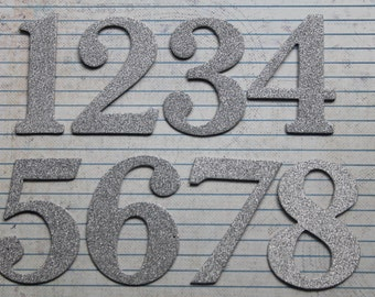 2 1/2 inch tall Numbers 1-12 silver fine glitter cardstock on top of chipboard diecuts great for wedding table numbers