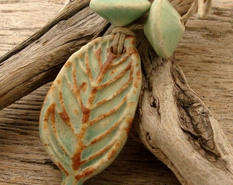 CERAMIC LEAF SET - Green with hints of Chocolate Brown Pendant with Two Top Shaped Beads - Handmade Ceramic Pendant Set