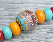 Bumpy Mumbai - Lampwork beads by Loupiac