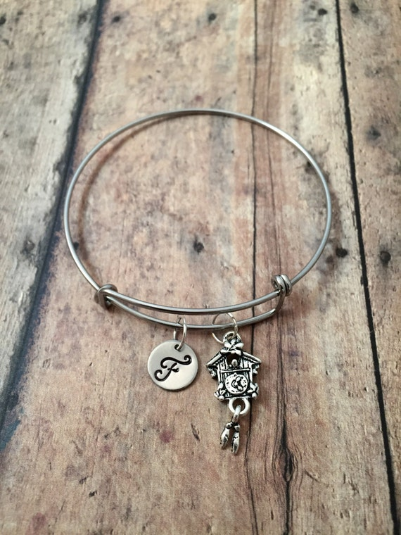 Cuckoo clock initial bangle