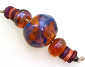 Handmade Lampwork Glass Bead - 3 bead set. Hollow focal, silver glass, shards, purple amber luster, coordinating earring pair.