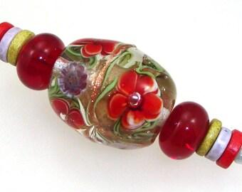 Handmade Lampwork Bead Set. Constance! 3 bead set. Encased floral. Red flowers, murrini, goldstone.