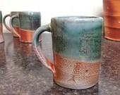 Coffee Mug. Soda Fired Stoneware with Copper Green Glaze.