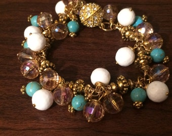Repurposed vintage pink crystal, white glass, turquoise and gold beaded bracelet.
