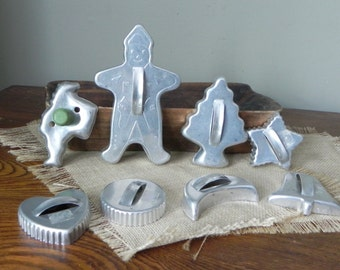 Eight vintage metal cookie cutters 1950s tree santa showman star circle heart crescent moon bell