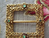 Valentines Day Sale Vintage buckle brooch gold tone with emerald green rhinestones