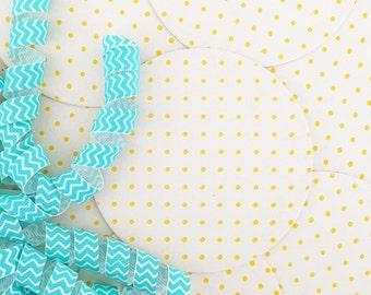 Set of eight yellow polka dot letterpress coasters