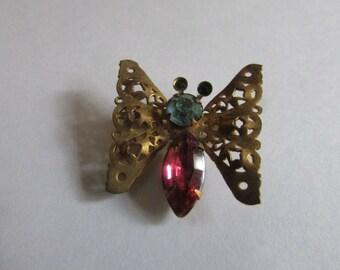 pink blue filgree butterfly