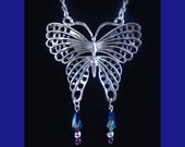 Large Butterfly pendant on chain with iridescent beads