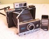 Polaroid 450 land camera and flash
