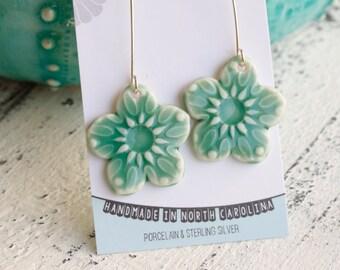long dangle flower earrings in aqua