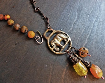 Trumpeting My Arrival. Chunky orange necklace with elephant and amber. Mixed media assemblage artisan jewelry by fancifuldevices.