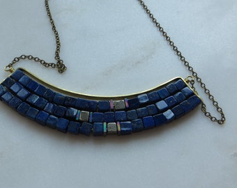 large brass arc with lapis lazuli and pyrite necklace
